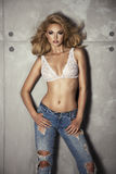 Fit and woman only in jeans. Royalty Free Stock Photo