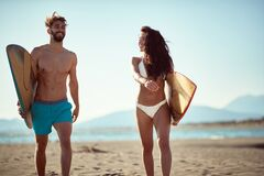 Free Fit, Sexy, Young  Couple Walking And Talking On Beach, Holding Surfboards, Smiling Royalty Free Stock Photography - 188416587