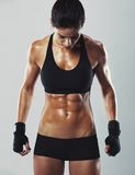 Fit and sexy young female bodybuilder Stock Images