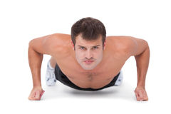 Fit shirtless man doing push ups Royalty Free Stock Photo
