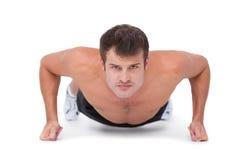 Fit shirtless man doing push ups Royalty Free Stock Photo