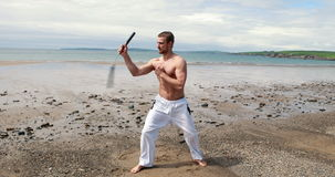 Fit shirtless man practicing martial arts stock footage