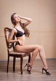 Fit slender sensual lingerie brunette. Royalty Free Stock Photos