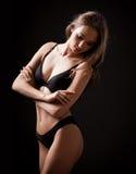 Fit slender sensual lingerie brunette. Stock Photos