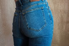 Fit slim female butt in blue jeans. Woman buttocks in denim. Concept Royalty Free Stock Images