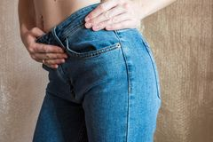 Fit slim female butt in blue jeans. Woman buttocks in denim. Concept Stock Photography
