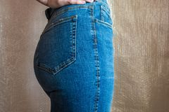 Fit slim female butt in blue jeans. Woman buttocks in denim. Concept Stock Image