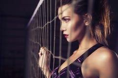 Fit slim young beautiful brunette woman in sportswear standing n Stock Photo