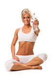 Fit a smiling blond woman holding a mineral water Royalty Free Stock Photos