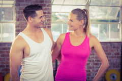 Fit smiling couple in crossfit Stock Photos