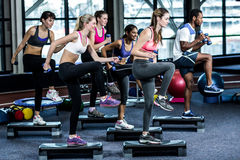 Fit smiling group doing exercise Royalty Free Stock Photography