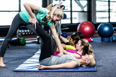 Fit smiling group doing stretching Royalty Free Stock Photo