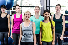 Fit smiling group standing straight Royalty Free Stock Photos