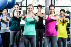 Fit smiling group with thumbs up Royalty Free Stock Image