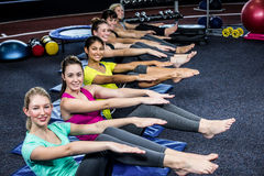 Fit smiling group working abs Royalty Free Stock Images