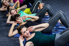 Fit smiling group working abs Royalty Free Stock Photo