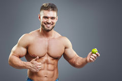 Fit smiling man holding a fresh lime Royalty Free Stock Image