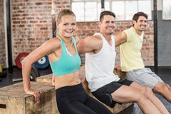 Fit smiling people doing some exercises with box Stock Photo