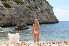 Fit smiling woman in bikini holding snorkeling Stock Photo