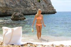 Fit smiling woman in bikini holding snorkeling Stock Image