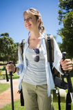 Fit smiling woman going for a hike Stock Images