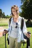 Fit smiling woman going for a hike Royalty Free Stock Image