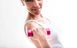 Fit smiling woman lifting weights Stock Photo