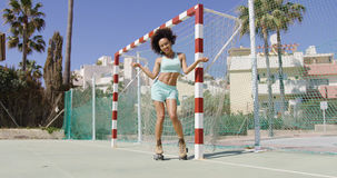 Fit smiling woman in roller skates Stock Image