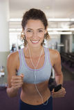 Fit smiling woman running on the treadmill Royalty Free Stock Photography