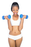 Fit smiling woman working out with dumbbells Royalty Free Stock Photo