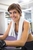Fit smiling woman working out on the exercise bike Royalty Free Stock Images