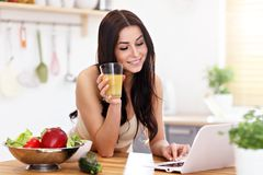 Fit smiling young woman with healthy juice in modern kitchen. Picture showing fit smiling young woman with healthy juice in modern kitchen Stock Images