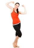 Fit sportig kvinna som slader båda armar Arkivbilder