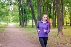 Fit sportive women jogging in the park Stock Images
