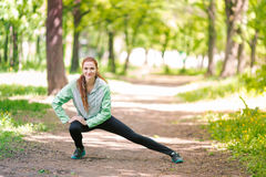 Fit sportive women stretching in the park Stock Images