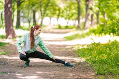 Fit sportive women stretching in the park Royalty Free Stock Photo