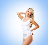 Fit and sporty girl in white underwear. Beautiful and healthy wo Royalty Free Stock Photography