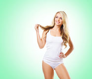 Fit and sporty girl in white underwear. Beautiful and healthy wo Royalty Free Stock Images
