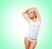 Fit and sporty girl in white underwear. Beautiful and healthy wo Royalty Free Stock Image