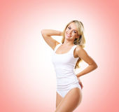 Fit and sporty girl in white underwear. Beautiful and healthy wo Stock Photo