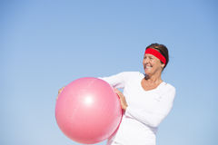 Fit and sporty senior woman exercising Stock Images