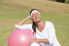 Fit and sporty senior woman relaxed outdoor Royalty Free Stock Images