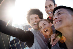 Fit and sporty team using mobile phone in the city. Stock Photography
