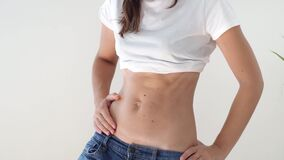 Fit sporty woman with abs and c-section scar. Postpartum recovery