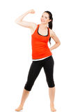 Fit sporty woman flexing muscles Stock Photo