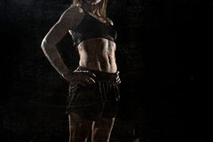 Fit and strong sport woman holding posing defiant in cool attitude with welt built body Royalty Free Stock Photos