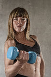 Fit and strong sport woman holding weight on her hand posing defiant in cool attitude Royalty Free Stock Image