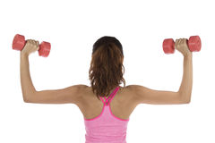 Fit strong woman strength training with dumbbells Stock Photo