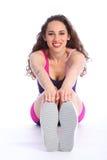 fit sunda sträckande toes som trycker på kvinnan Arkivbilder