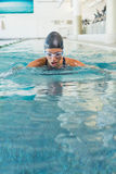 Fit swimmer coming up for air in the swimming pool Stock Photography
